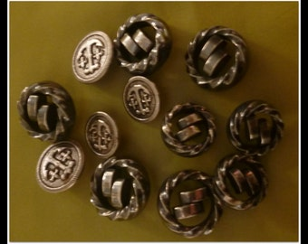 BUTTONS 12.Silver coloured 1970's plastic buttons.