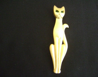 A.J.C Gold tone Cat with Emerald eyes