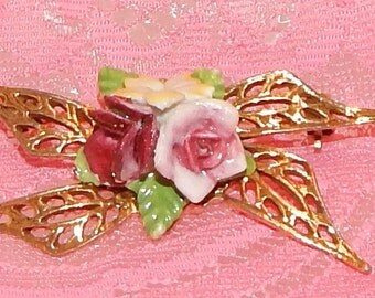 Vintage Porcelain Rose Brooch with Gold tone metal Ribbons Pink rose, yellow, and Dark pink Flowers