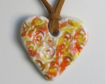 Ceramic Heart Pendant on a Golden Brown Micro Fiber Suede Cord