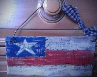 Primitive american flag painted on a pallet board. Rustic Americana.