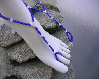 Blue and white bare foot sandals.
