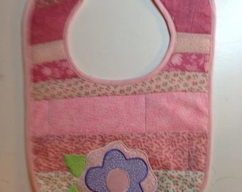 Pink baby bib with flower