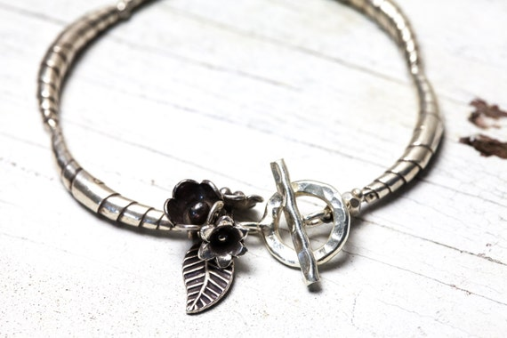 Fine silver croissant bead bracelet with flower and leaf cluster and toggle closure handmade by ladeDAH! jewelry.