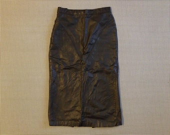 1980's, black, leather, long pencil skirt, with snaps at the bottom of the back