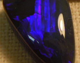 Solid natural Lightning Ridge black opal with purple blue 18.86ct