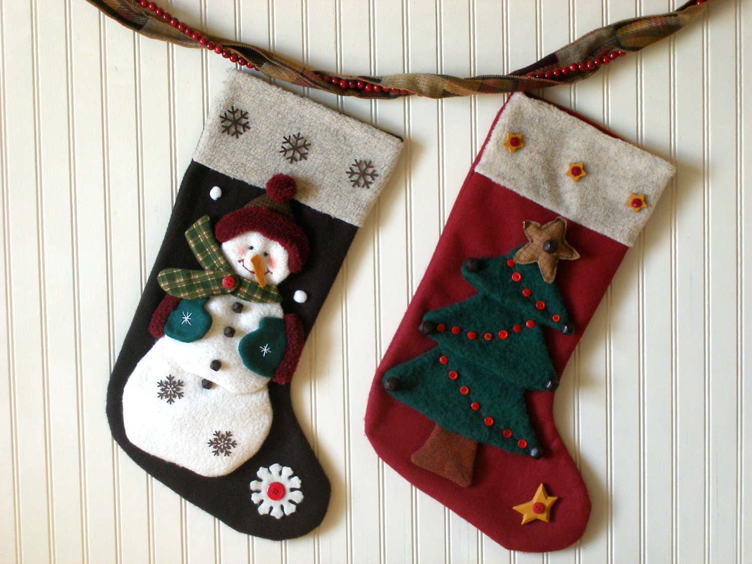 Cut out a large piece of white felt and measure it against the top of the stocking for the cuff. You want the pieces to cover 3/4in of the top of the stocking and to extend 1/2in or so beyond the edges of the stocking so they can be stitched together later.