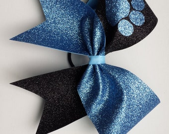 Columbia blue and black paw cheer bow. Ask about bulk discounts, color and mascot options.