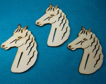 3 horse heads, wood, 8 x 6 cm  (10-0027A)