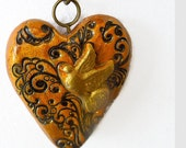 Lacy heart with dove pendant