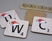 Four Personalized Christmas Scrabble Coasters - Letters wearing red Santa Hat