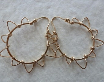 hammered gold freeform rays wrap onto hoops of Sunshine on My Shoulders Earrings