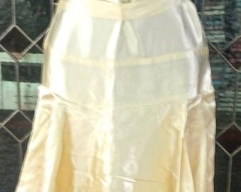 a twenties,thirties tiered tea length dress in champagne satin for wedding or debutante