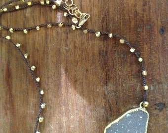 Druzy pendant with braided pyrite beads