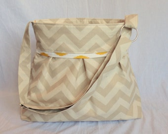 Pleated Diaper Bag large in tan and natural chevron with yellow polka dot lining.  Adjustabe strap with elastic bottle pockets