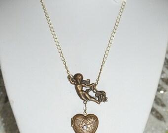 Beautiful Victorian era Angel with heart Locket