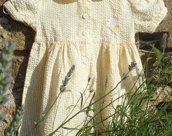 French child's dress in a yellow stripe.