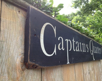 Captains corner sign distressed black and white