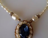 """VTG signed """"MARIAM HASKELL"""" Baroque Pearl Necklace w/ Beautiful Antiqued Russian Gold-Tone Setting Featuring Lrg Sapphire Blue Glass Stone."""