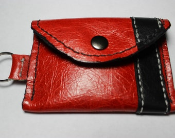 Hand stitched, Red leather change/credit card pouch/purse.  Black leather lining and accents including key chain.