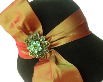 Moss green cloche hat with irredescent taffeta and pin made by hand..made in America