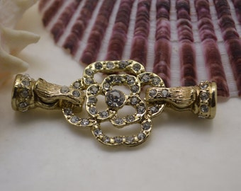 Gold plated with rhinestones easy on and off, both end open magnetic clasp