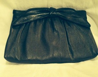 Mod Leather-Like Clutch with a Bow at Handle