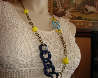 1960's blue and yellow single strand eclectic asymmetrical necklace.  Classic 60's necklace.  Blues, yellows and antique gold chain.