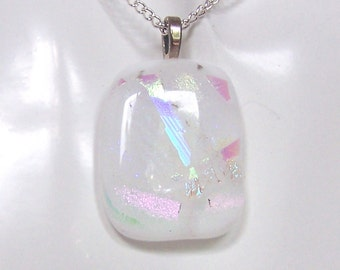Cream white glass pendant with dichroic pearl iridescent accents. Silver finish bail.