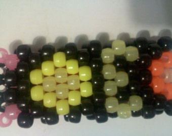 Kandi Bracelet With the Letters EDC and Daisy's Between Letters Glow in Dark Pony Beads PLUR