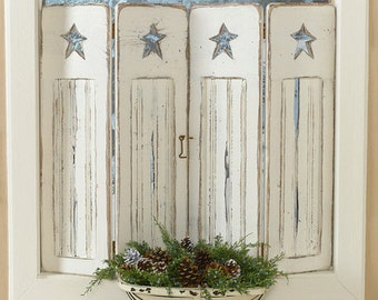 Rustic beadboard shutters with primitive star cutout in distressed creamy white