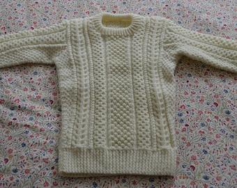 Child's hand-knit Irish sweater, classic Aran Island design