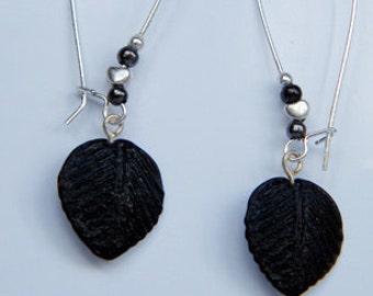 Jet black glass leaves on kidney hoops