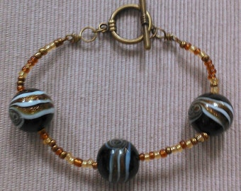 glitter bracelet (large): lampwork and glass beads, antique golden accents