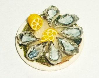 Dollhouse miniature dish with seafood, oysters, lemon, ice algae. 1:12