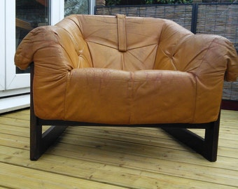 A Percival Lafer leather and rosewood mid century lounge chair