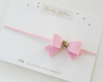 Girl/Baby, Baby Pink Mini Felt Bow on pink skinny elastic headband with gold glitter fabric detail.