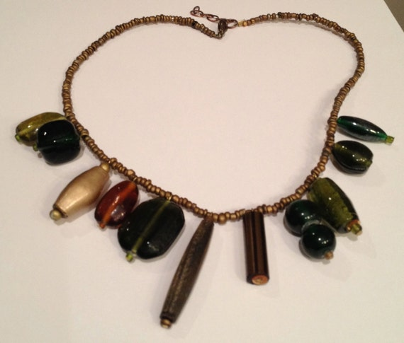 Fall colors beaded necklace with golden, wood, metal and glass ceramic beads.