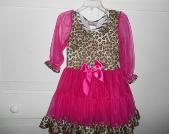 Cute, cute nightgown in leopard print with hot pink.  Very prissy.