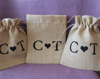 Rustic burlap wedding favor bag.  Burlap welcome bag.  Personalized burlap wedding, shower, or party favor.  Initials and heart design bags