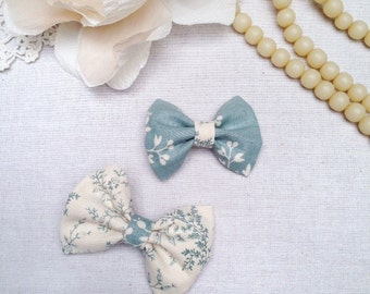 A Pair of Blue and Cream Bow Hair Clips for Babies or Bigger Girls