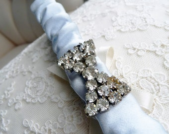 Blue silk garter with vintage brooch