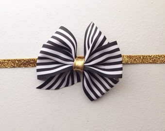 The Audrey black and white striped bow over gold Headband
