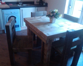 Chunky solid wood handmade dining table, garden table and four chairs. CAVEMAN FURNITURE