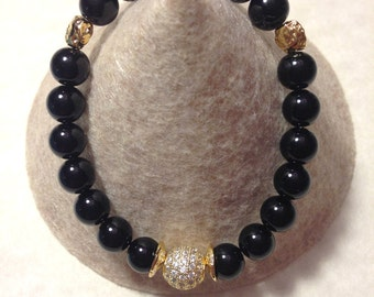 Black onyx  stretch bracelet with gold plated details