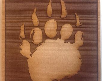 Cedar wood coaster set of 4 with laser engraved bear print.