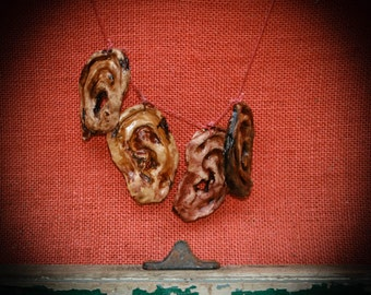 Severed ear necklace