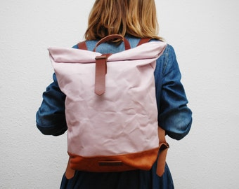 Waxed Canvas rucksack/backpack,  soft pink color, hand waxed , with handles, leather base and  closures