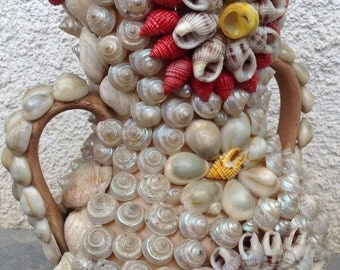 Vintage Amphora covered with shells