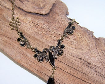 Vintage inspired Statement piece, black stones with ornate antique gold setting and chain